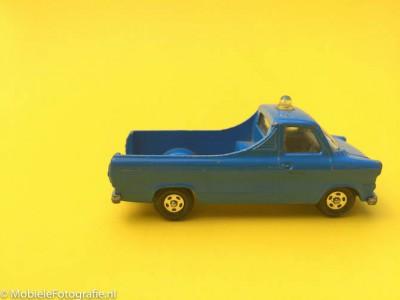 Uitleg van de regel van ruimte in de fotografie: geen ruimte voor het speelgoedautootje.