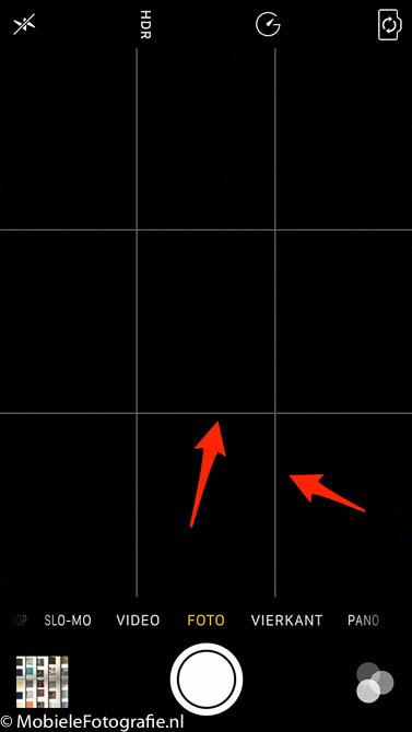 De standaard IOS (iPhone) camera app met hulplijnen.