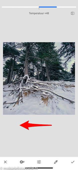 Maak je foto iets witter in Snapseed. door de automatisch ingestelde waarde te verminderen.